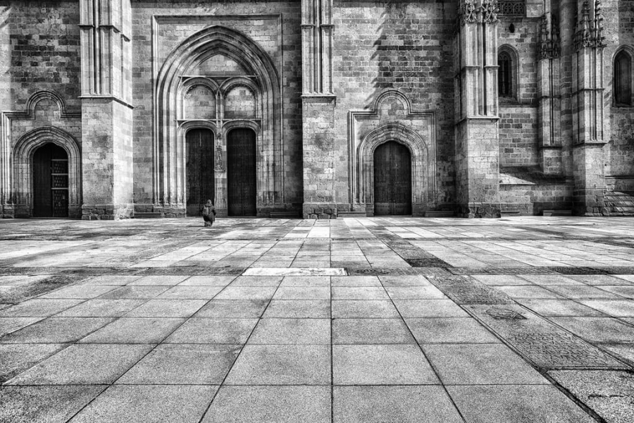 Praying at the foot of the cathedral
